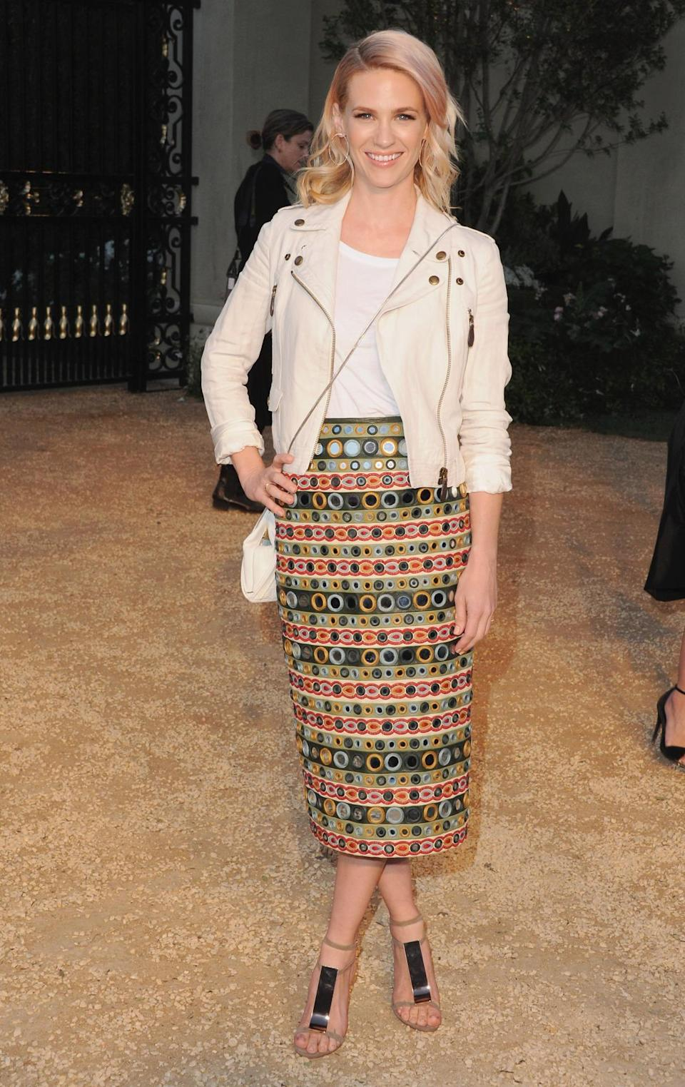 "The ""Mad Men"" actress's multi-colored embroidered Burberry skirt paired with a white T-shirt, and matching cross-body bag complimented her pink hair perfectly."