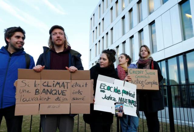 Activists protest outside the District Court of West Lausanne before the trial of twelve activists for a protest inside a branch of Credit Suisse bank in 2018 in Renens
