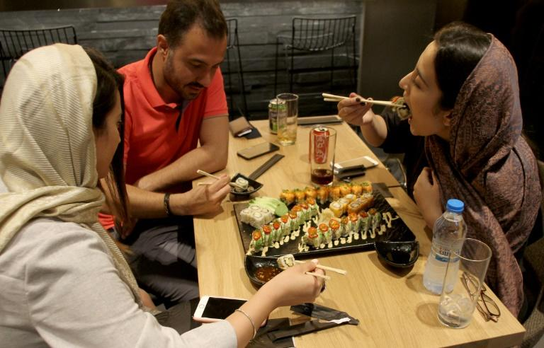 Iranians eat out at a high-end French sushi chain that opened this month in northern Tehran