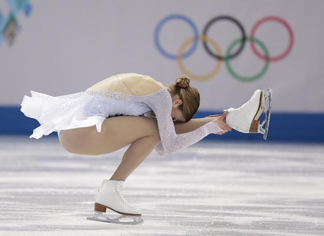 Carolina Kostner of Italy competes in the women's short program figure skating competition at the Iceberg Skating Palace during the 2014 Winter Olympics, Wednesday, Feb. 19, 2014, in Sochi, Russia. (AP Photo/Bernat Armangue)