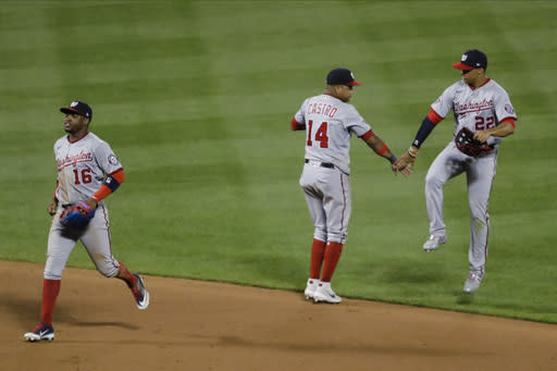 Washington Nationals' Victor Robles (16) celebrates with teammates Starlin Castro (14) and Juan Soto (22) after a baseball game against the New York Mets Tuesday, Aug. 11, 2020, in New York. The Nationals won 2-1. (AP Photo/Frank Franklin II)
