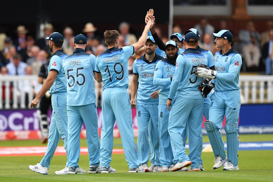 LONDON, ENGLAND - JULY 14: Chris Woakes of England celebrates with his teammates after dismissing Martin Guptill of New Zealand during the Final of the ICC Cricket World Cup 2019 between New Zealand and England at Lord's Cricket Ground on July 14, 2019 in London, England. (Photo by Mike Hewitt/Getty Images)