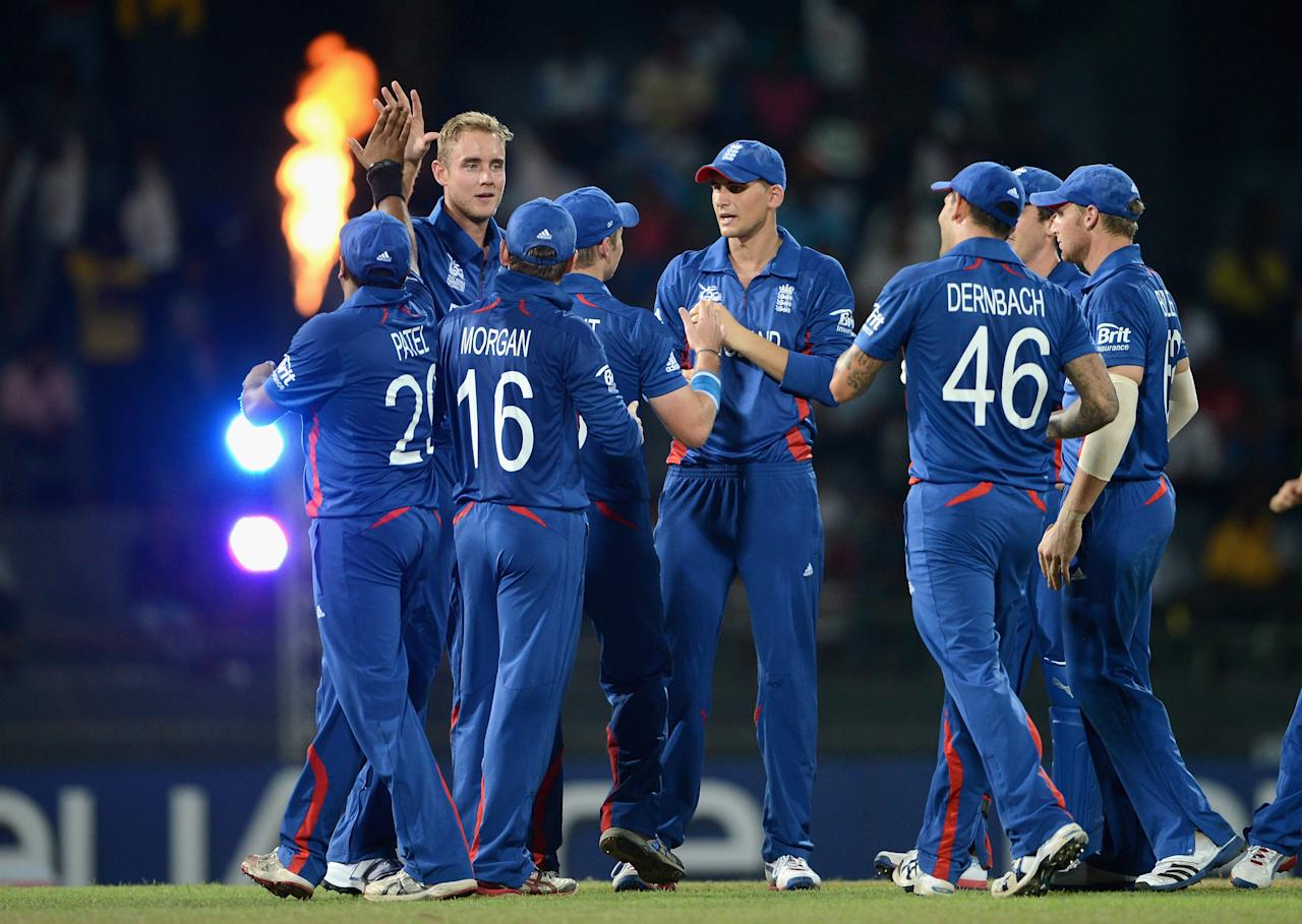 COLOMBO, SRI LANKA - SEPTEMBER 21:  England captain Stuart Broad celebrates with teammates after dismissing Nawroz Mangal of Afghanistan during the ICC World Twenty20 2012 Group A match between England and Afghanistan at R. Premadasa Stadium on September 21, 2012 in Colombo, Sri Lanka.  (Photo by Gareth Copley/Getty Images)
