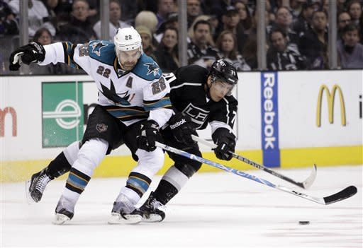 San Jose Sharks defenseman Dan Boyle, left, and Los Angeles Kings center Jordan Nolan fight for the puck during the first period of an NHL hockey game in Los Angeles, Tuesday, March 20, 2012. (AP Photo/Jae C. Hong)