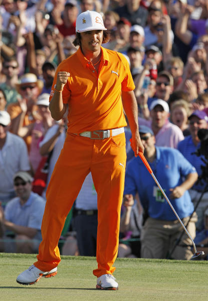 Rickie Fowler reacts after making a birdie putt to win the Wells Fargo Championship golf tournament on the first playoff hole at Quail Hollow Club in Charlotte, N.C., Sunday, May 6, 2012. (AP Photo/Gerry Broome)