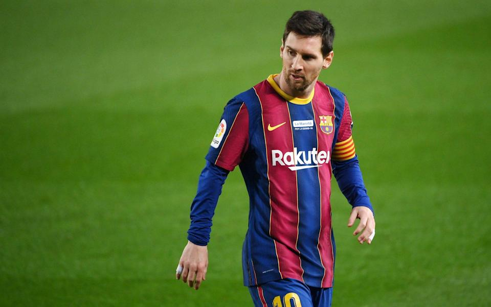 Barcelona's Argentinian forward Lionel Messi walks on the pitch during the Spanish league football match between FC Barcelona and Valencia CF at the Camp Nou stadium in Barcelona on December 19, 2020. - GETTY IMAGES