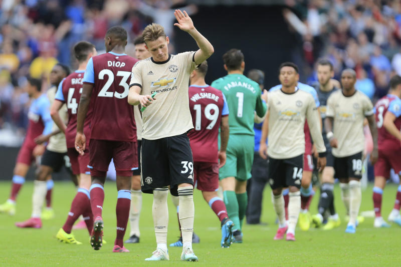 Manchester United's Scott McTominay salutes supporters at at the end of the English Premier League soccer match between West Ham and Manchester United at London stadium in London, Sunday, Sept. 22, 2019. West Ham beat Manchester United 2-0. (AP Photo/Leila Coker)