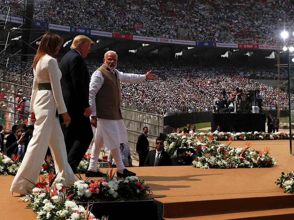 "U.S. President Donald Trump, first lady Melania Trump and Indian Prime Minister Narendra Modi arrive for a ""Namaste Trump"" event during Trump's visit to India, at Sardar Patel Gujarat Stadium, in Ahmedabad, India, February 24, 2020. REUTERS/Al Drago"