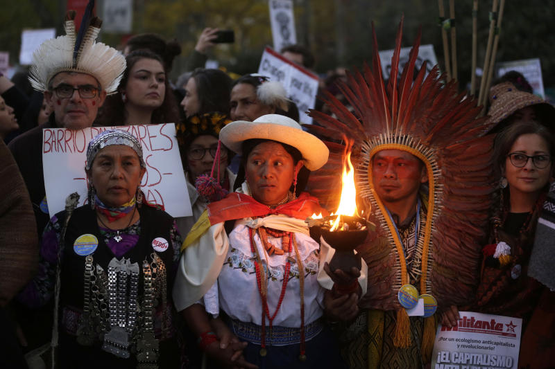 Demonstrators gather before marching in Madrid on the sidelines of UN climate talks, on Friday Dec. 6, 2019. (AP Photo/Paul White)