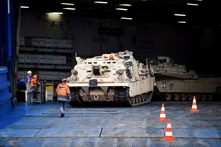 Tracked vehicles are unloaded from US vessel ARC Endurance at Bremerhaven, Germany on February 21, 2020.