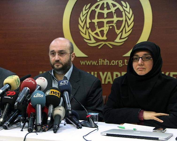 Yasar Kutluay, secretary general of the Humanitarian Relief Foundation, known by its Turkish initials IHH and which is close to the government, left, speaks to the media in Istanbul, Turkey, Tuesday, Jan. 14, 2014. Turkish anti-terrorism police carried out raids in six cities on Tuesday, detaining at least five people with alleged links to al-Qaida, including an employee of the IHH that provides aid to Syria, media reports and officials said. The police operation comes as Prime Minister Recep Tayyip Erdogan's government is fighting allegations of corruption it says were instigated by followers of a moderate Islamic movement, which it insists have infiltrated Turkey's police and judiciary and are out to discredit the government ahead of local elections in March. The IHH rejected any ties to al-Qaida.(AP Photo)