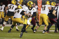 Missouri quarterback Connor Bazelak (8) looks for an open receiver during the second half of an NCAA college football game against South Carolina, Saturday, Nov. 21, 2020, in Columbia, S.C. (AP Photo/Sean Rayford)