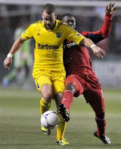 Columbus Crew's Josh Williams left, battles Chicago Fire's Patrick Nyarko right, for the ball during the first half of an MLS soccer match in Bridgeview, Ill., Saturday, Sept. 22, 2012. (AP Photo/Paul Beaty)