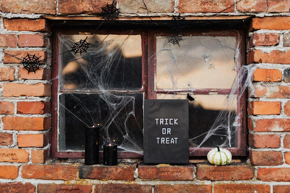 <p>Make this year feel a little more normal with this trick or treat backdrop.</p>