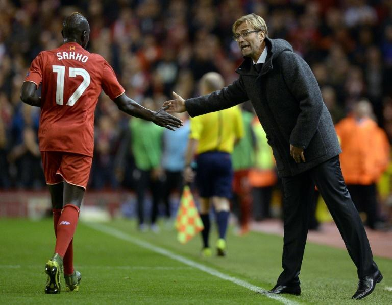 Exonerated: Jurgen Klopp (right) said he had known for a long time that Mamadou Sakho (left)was not guilty of doping