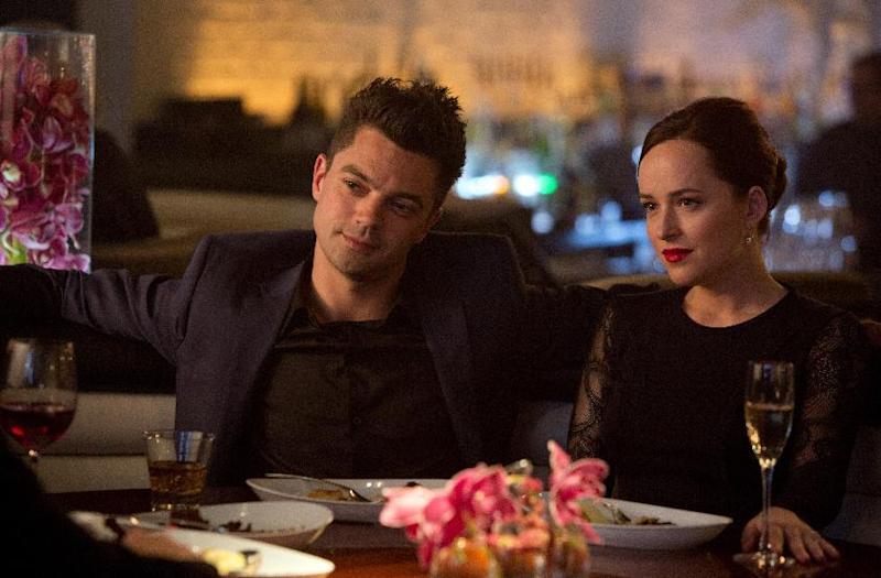 """This image released by DreamWorks II shows Dominic Cooper, left, and Dakota Johnson in a scene from """"Need for Speed."""" (AP Photo/DreamWorks II, Melinda Sue Gordon)"""
