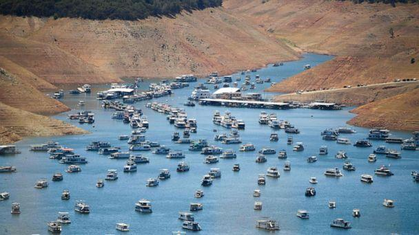 PHOTO: Houseboats are moored on Lake Oroville reservoir during the California drought emergency, May 25, 2021, in Oroville, Calif.  (Patrick T. Fallon/AFP via Getty Images)