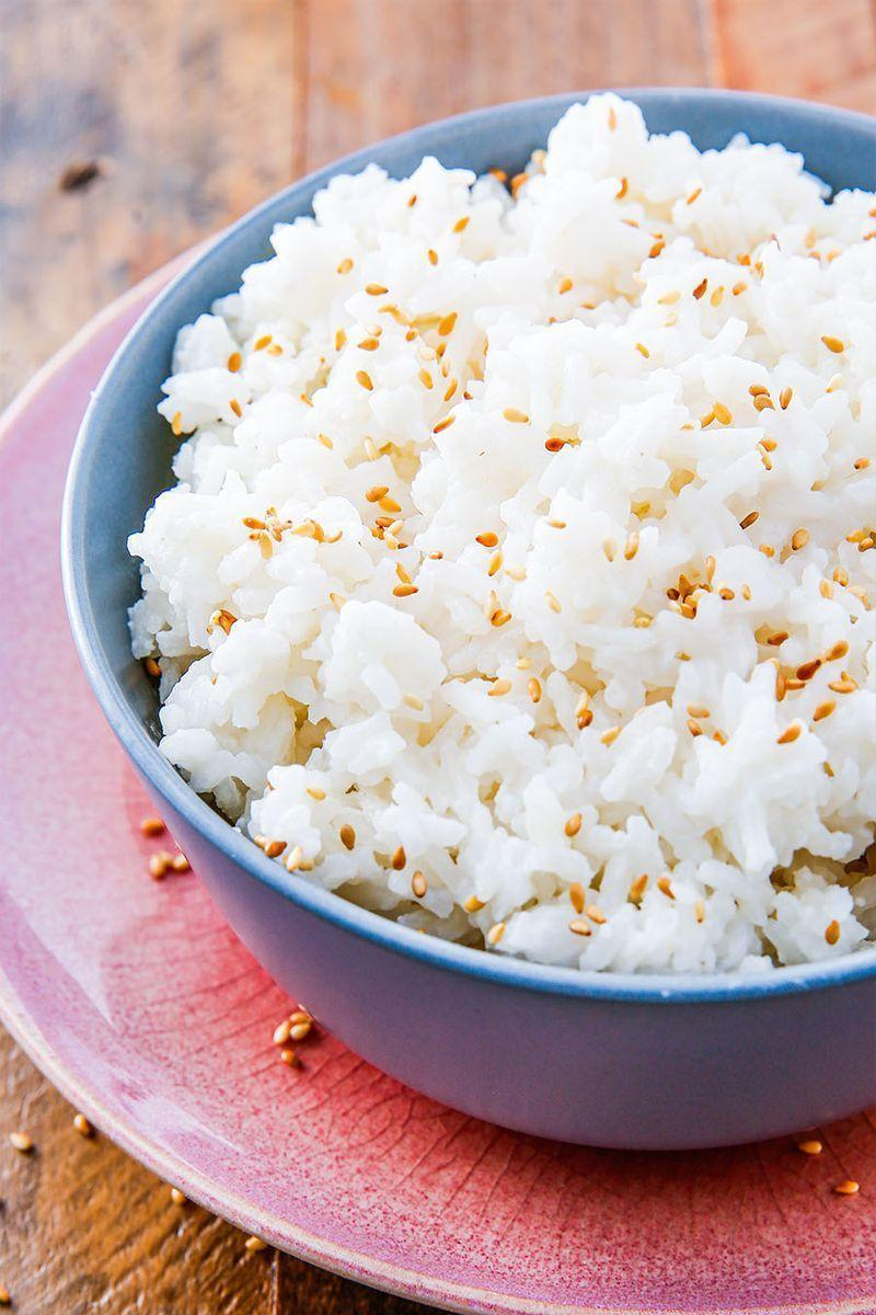 """<p>Coconut rice is a Thai style rice that uses a slightly different method than you would normally <a href=""""https://www.delish.com/uk/food-news/a28997170/how-to-cook-rice/"""" rel=""""nofollow noopener"""" target=""""_blank"""" data-ylk=""""slk:use to cook rice"""" class=""""link rapid-noclick-resp"""">use to cook rice</a>. Typically, you would bring the water to a boil first before adding the rice, but for coconut rice you bring the milk, water, and rice all to a boil together. It creates a slightly sticky, much more flavourful rice that we want to eat with everything. Especially with <a href=""""https://www.delish.com/uk/cooking/recipes/a28886245/easy-indian-chicken-curry-recipe/"""" rel=""""nofollow noopener"""" target=""""_blank"""" data-ylk=""""slk:chicken curry"""" class=""""link rapid-noclick-resp"""">chicken curry</a> and our favourite <a href=""""https://www.delish.com/uk/cooking/recipes/a29771277/pineapple-salmon-sheet-pan-dinner-recipe/"""" rel=""""nofollow noopener"""" target=""""_blank"""" data-ylk=""""slk:pineapple salmon"""" class=""""link rapid-noclick-resp"""">pineapple salmon</a>. </p><p>Get the <a href=""""https://www.delish.com/uk/cooking/recipes/a30493349/coconut-rice-recipe/"""" rel=""""nofollow noopener"""" target=""""_blank"""" data-ylk=""""slk:Coconut Rice"""" class=""""link rapid-noclick-resp"""">Coconut Rice</a> recipe.</p>"""