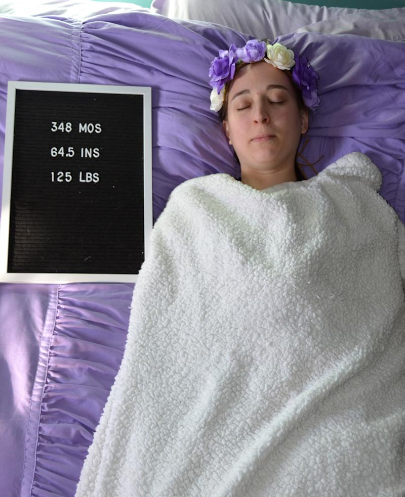 Krysti Yakonick can be seen posing for a sequence of photos – while wrapped in a blanket with her eyes closed. [Photo: Caters]