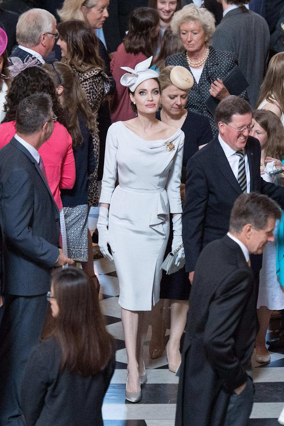 <p>On 28 June, Angelina Jolie gave Kate and Meghan a run for their money in the fashion department. The actress chose a regal Ralph and Russo dress for the 200th anniversary Order of St Michael and St George service at St Paul's Cathedral. Sadly, the Queen had to skip the event due to ill health and couldn't appreciate the outfit. <em>[Photo: Getty]</em> </p>