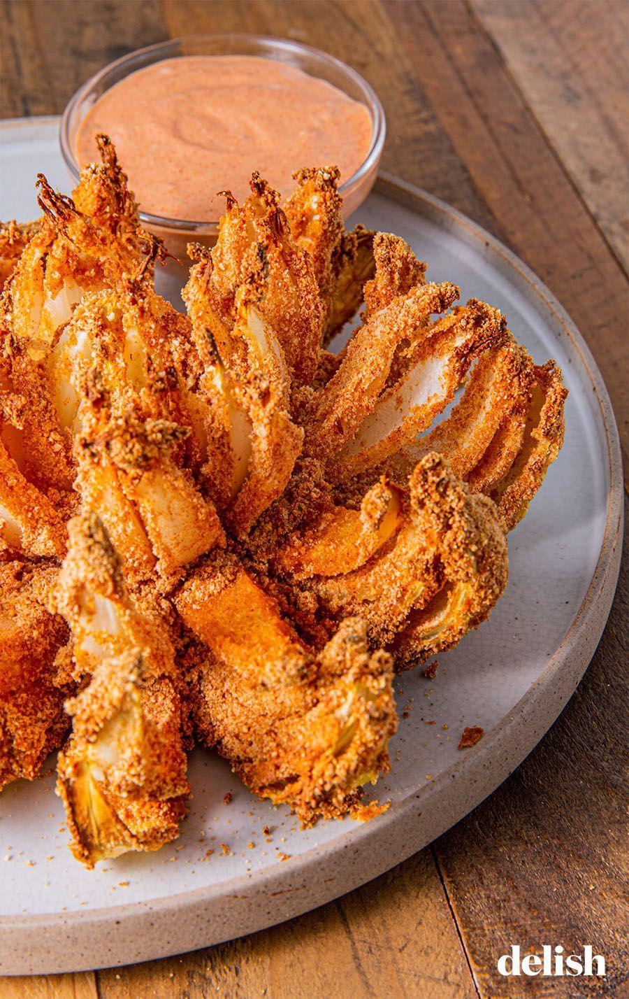 "<p>The Outback secret sauce is essential.</p><p>Get the recipe from <a href=""https://www.delish.com/cooking/recipe-ideas/a28650227/air-fryer-blooming-onion/"" rel=""nofollow noopener"" target=""_blank"" data-ylk=""slk:Delish"" class=""link rapid-noclick-resp"">Delish</a>.</p>"