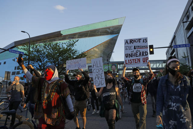 Protesters gather outside the Minnesota Vikings football stadium Friday, May 29, 2020, in Minneapolis. Protests continued following the death of George Floyd, who died after being restrained by Minneapolis police officers on Memorial Day. (AP Photo/Julio Cortez)