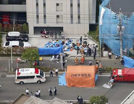 An aerial view shows rescue workers and police officers operate at the site where sixteen people were injured in a suspected stabbing by a man, in Kawasaki, Japan May 28, 2019. in this photo released by Kyodo. Mandatory credit Kyodo/via REUTERS