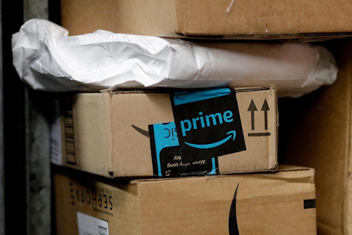 Consumers who love to shop online are warned about various scams that could kick up around Amazon Prime Day, which runs 36-hours this year and begins Monday afternoon. File photo, a package from Amazon Prime is loaded for delivery in New York. (AP Photo/Mark Lennihan, File)
