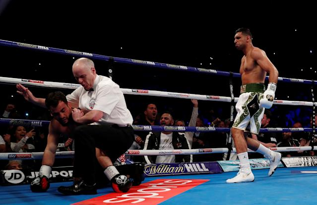 Boxing - Amir Khan v Phil Lo Greco - Echo Arena, Liverpool, Britain - April 21, 2018 Amir Khan knocks down Phil Lo Greco and the referee stops the fight Action Images via Reuters/Andrew Couldridge