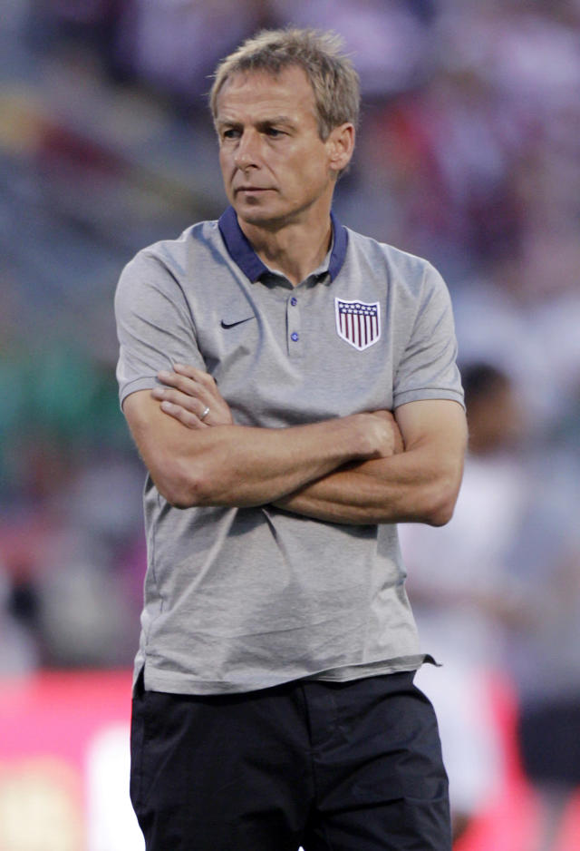 United States manager Jurgen Klinsmann watches his team warm before their World Cup qualifying soccer match against Mexico Tuesday, Sept. 10, 2013, in Columbus, Ohio. (AP Photo/Jay LaPrete)