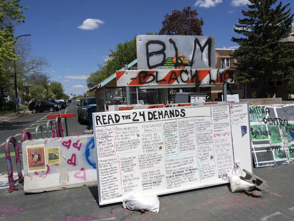 A barricade at one of the entrances to George Floyd Square is marked with a list of demands from the site's caretakers. (Judy Griesedieck for Yahoo News)