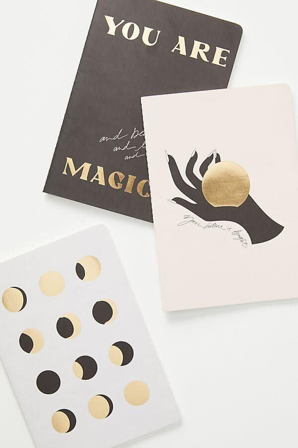 """If your friend loves to unwind by writing down the day's happenings, these magic-themed journals will probably hold some inspiration. Plus, it's a reminder that they are magical to you, too.&nbsp;<strong><a href=""""https://fave.co/33Y33O4"""" rel=""""nofollow noopener"""" target=""""_blank"""" data-ylk=""""slk:Get the set for $18 at Anthropologie"""" class=""""link rapid-noclick-resp"""">Get the set for $18 at Anthropologie</a></strong>.&nbsp;"""