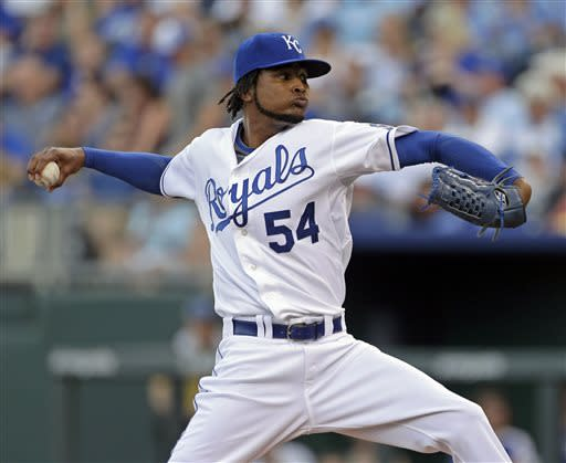Kansas City Royals starting pitcher Ervin Santana throws during the first inning of a baseball game against the Detroit Tigers, Friday, July 19, 2013, in Kansas City, Mo. (AP Photo/Charlie Riedel)