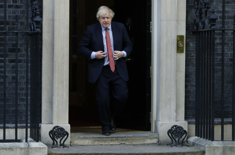 "Britain's Prime Minister Boris Johnson comes out to applaud on the doorstep of 10 Downing Street, during the weekly ""Clap for our Carers"", in London, Thursday, May 28, 2020. The COVID-19 coronavirus pandemic has prompted a public display of appreciation for care workers. The applause takes place across Britain every Thursday at 8pm local time to show appreciation for healthcare workers, emergency services, armed services, delivery drivers, shop workers, teachers, waste collectors, manufacturers, postal workers, cleaners, vets, engineers and all those helping people with coronavirus and keeping the country functioning while most people stay at home in the lockdown. (AP Photo/Kirsty Wigglesworth)"