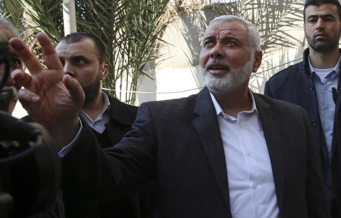 FILE - In this March 27, 2019 file photo, Hamas' supreme leader Ismail Haniyeh tours the site of a destroyed building, in Gaza City. Palestinian President Mahmoud Abbas has announced that the first presidential and parliamentary elections since 2006 will be held later in 2021. The voting is seen as a key step in mending a rift between Abbas' Fatah party that rules the West Bank and the Islamic militant group Hamas that controls the Gaza Strip. ( (AP Photo/Adel Hana, File)