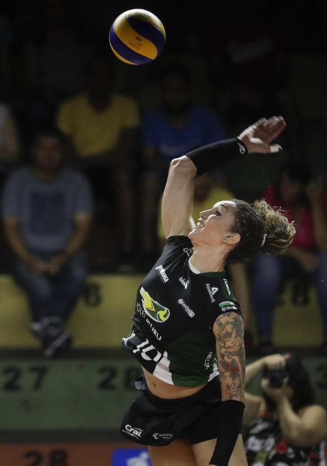 Bauru's volleyball player Tiffany Abreu spikes during a Brazilian volleyball league match in Bauru, Brazil, Tuesday, Dec. 19, 2017. Abreu is Brazil's first transgender person to play in top volleyball league for women and before her gender transition in 2014, Abreu played in men's leagues in Portugal, France, Indonesia, Spain, France and Belgium. (AP Photo/Andre Penner)