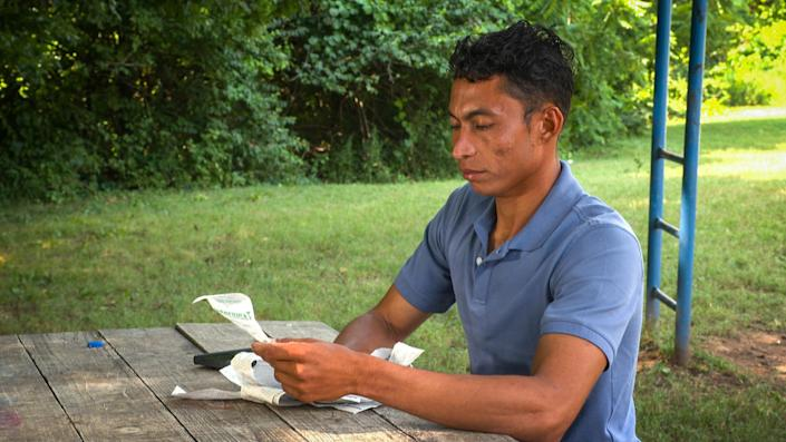 Denis Sanabria looks at the receipts for the payments he made to his brother David's kidnappers. (Noticias Telemundo Investiga)