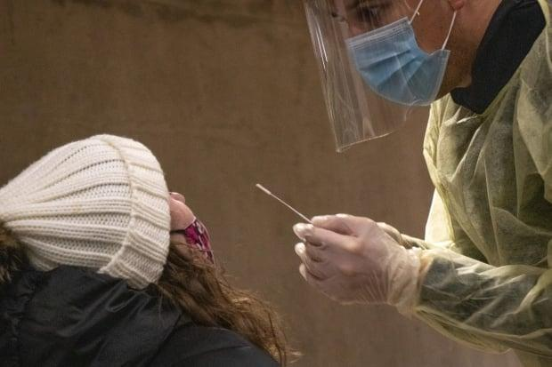 A worker administers a COVID-19 test at a rapid-testing event at Dalhousie University on Tuesday, Nov. 24. Nova Scotia announced seven new cases of the virus on Monday. (Robert Short/CBC - image credit)