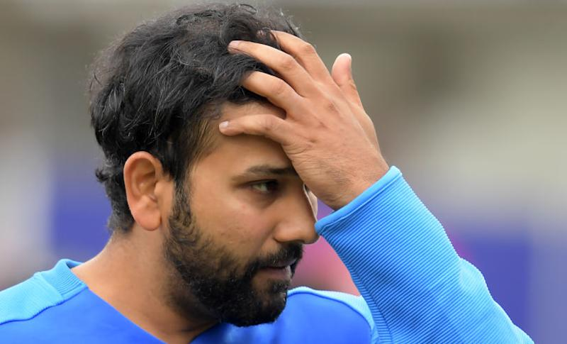 India's Rohit Sharma reacts at the end of play during the 2019 Cricket World Cup first semi-final between New Zealand and India at Old Trafford in Manchester, northwest England, on July 10, 2019. - New Zealand beat India by 18 runs. (Photo by Dibyangshu Sarkar / AFP) / RESTRICTED TO EDITORIAL USE
