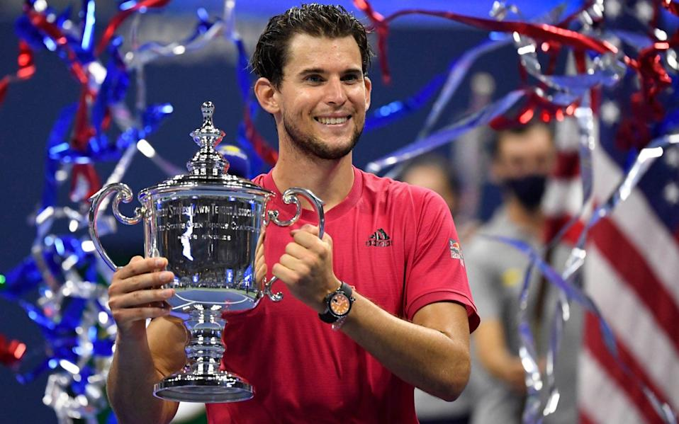 Dominic Thiem of Austria celebrates with the championship trophy - USA TODAY Sports