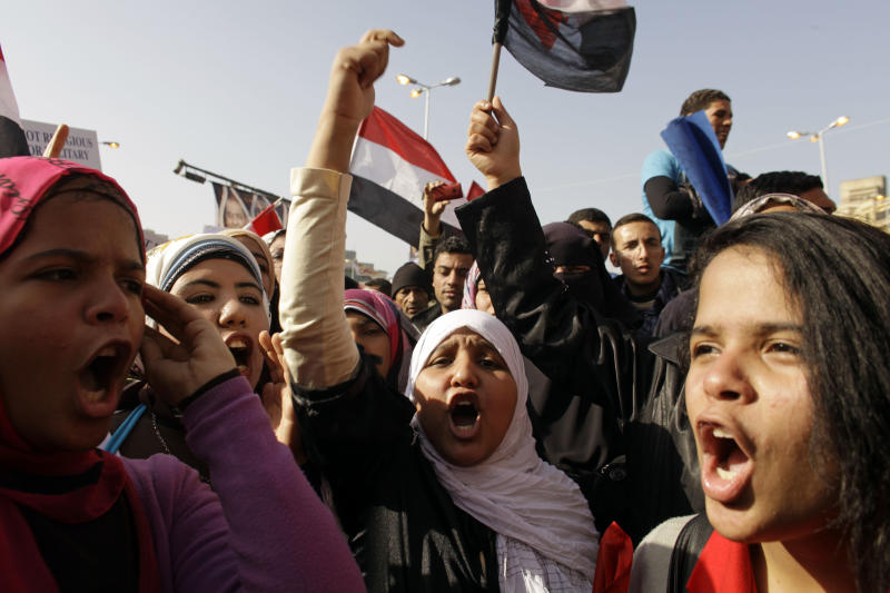 FILE - In this Wednesday, Jan. 25, 2012 file photo, Egyptian girls chant slogans in Tahrir Square during a rally to mark the one year anniversary of the uprising that ousted President Hosni Mubarak in Cairo, Egypt. Egyptian women are growing increasingly angry and militant as they deal with one of the unintended consequences of the uprising _ an epidemic of sexual assault. The angry backlash, which includes self-defense courses and even threats of violent retaliation, is fueled by ultraconservative Islamists who suggest women invite assault by attending anti-government protests where they mix with men. (AP Photo/Maya Alleruzzo, File)
