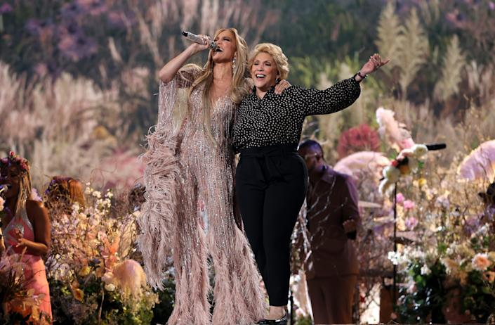 """Jennifer Lopez, left, and her mother, Guadalupe Rodriguez, sing """"Sweet Caroline"""" at the """"Vax Live"""" concert in Inglewood, Calif., on May 2, 2021. Rodriguez sang the Neil Diamond tune to Lopez when she was a baby, renaming it """"Sweet Jennifer."""""""