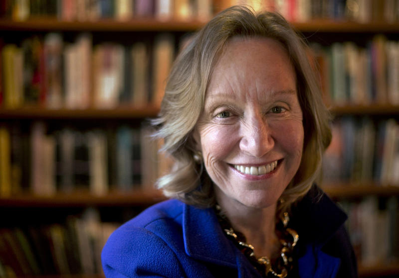 """In this Monday, Oct. 7, 2013 photo author Doris Kearns Goodwin stands near a bookshelf for a portrait at her home in Concord, Mass. Goodwin's latest book,""""The Bully Pulpit: Theodore Roosevelt, William Howard Taft, and the Golden Age of Journalism,"""" will be released on Nov. 5. (AP Photo/Steven Senne)"""