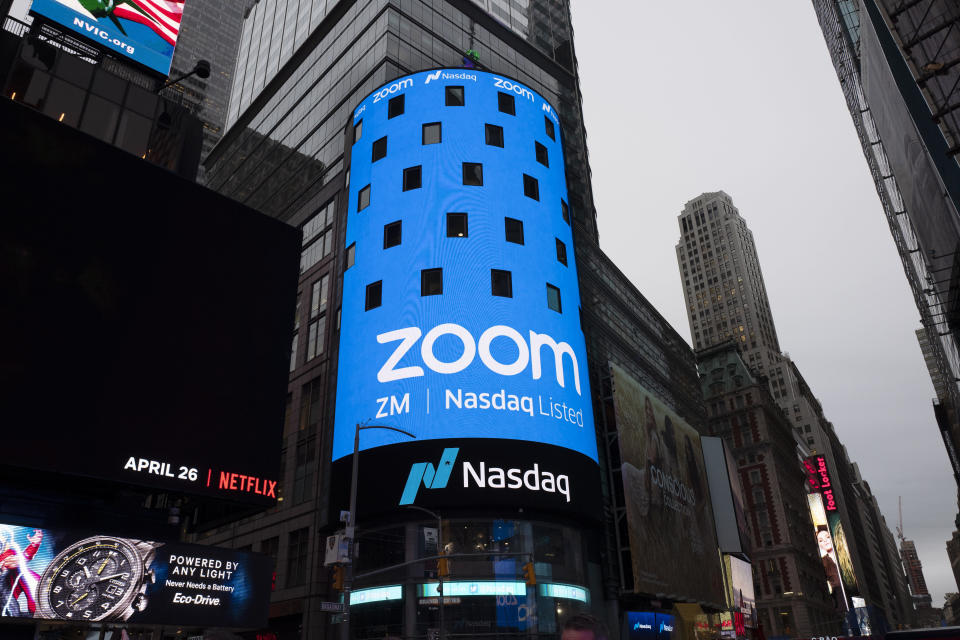 FILE - In this April 18, 2019, file photo shows a sign for Zoom Video Communications ahead Nasdaq IPO in New York. Zoom's stock touched $110 during trading Monday, Feb. 24, 2020, a level it's reached just once since its shares began trading last spring. The company has said it's seeing more business for people wanting to meet online. (AP Photo/Mark Lennihan, File)