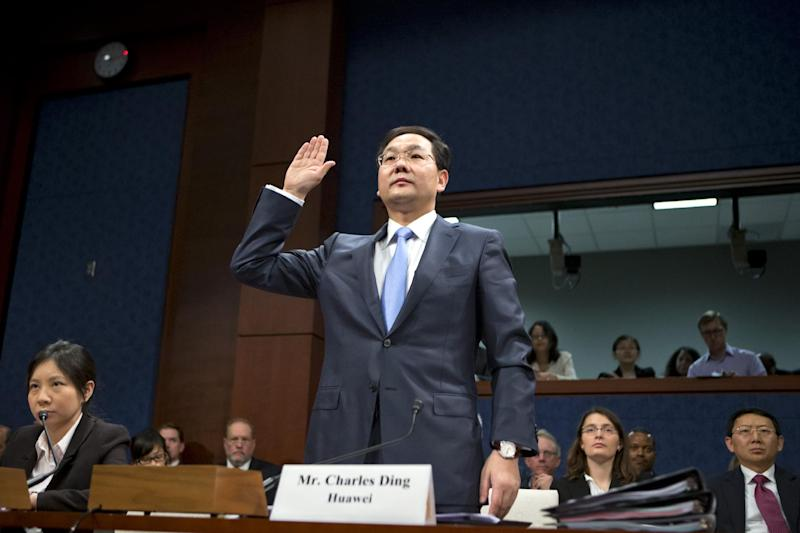 Charles Ding, Huawei Technologies Ltd's senior vice president for the U.S., is sworn in on Capitol Hill in Washington, Thursday, Sept. 13, 2012, prior to testifying before the House Intelligence Committee as lawmakers probe whether Chinese tech giants' expansion in the U.S. market pose a threat to national security.  (AP Photo/J. Scott Applewhite)