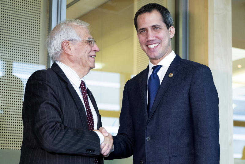 European Union foreign policy chief Josep Borrell, right, shakes hands with the leader of Venezuela's political opposition Juan Guaido prior to a meeting at EU headquarters on Wednesday, Jan. 22, 2020. (Aris Oikonomou, Pool Photo via AP)