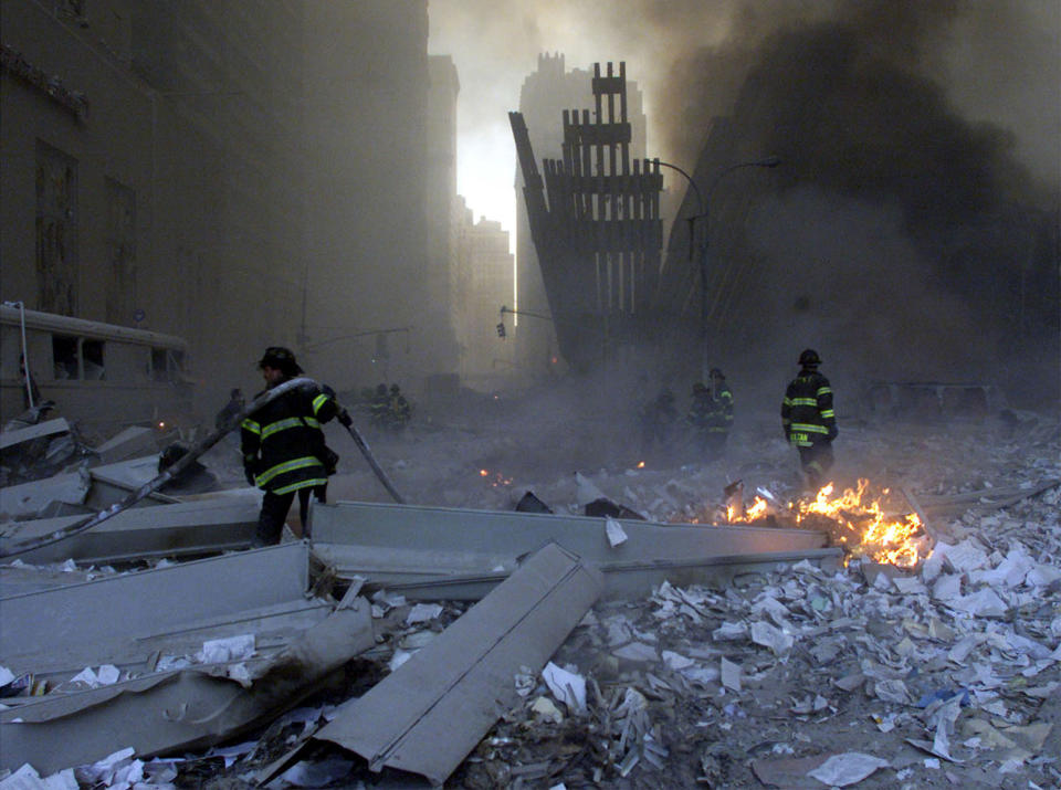 <p>Firemen work around the World Trade Center after both towers collapsed in New York. (Reuters)</p>