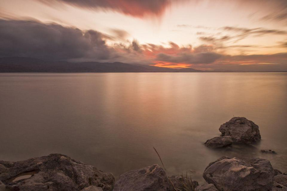 <p>The angelic sky and mirrored waters of Lake Trichonida create a picture-perfect view in Eastern Greece.</p>