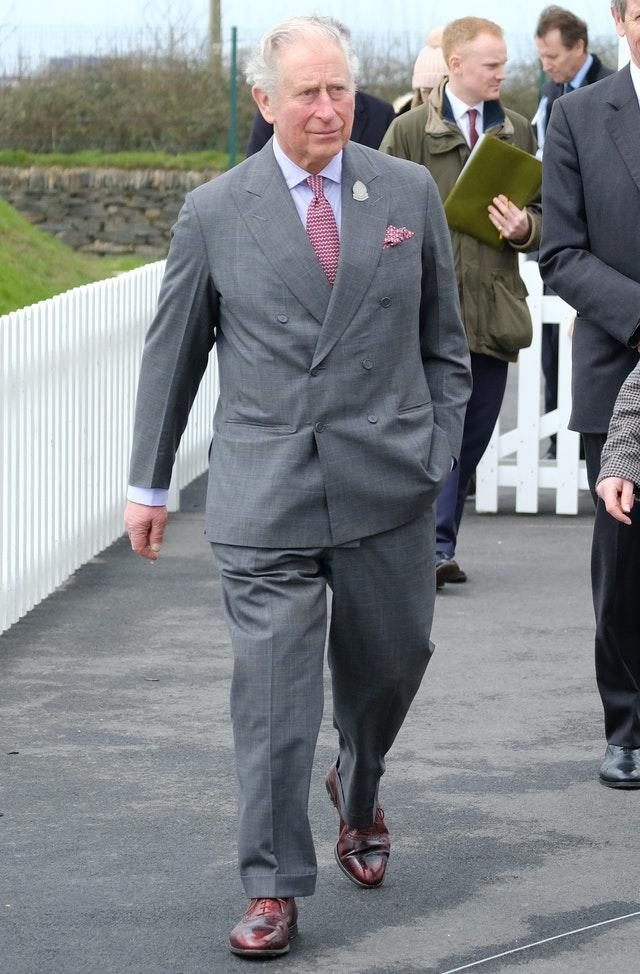 The prince is known for his love of double-breasted suits. Matt Keeble/PA Wire