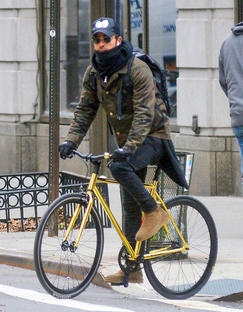 Justin Theroux biking in New York City on Feb. 11, Aniston's birthday.
